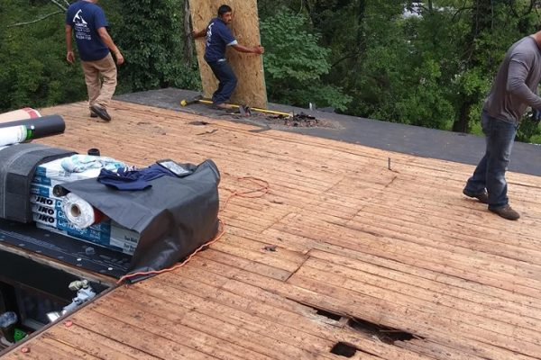 Merrick Contracting Employees working on a roof replacement in Hebron KY